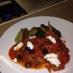 Veal with tomato sauce & black olives. & goat cheese.