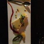 "Dessert.  Mango ""flan"" with sugar coated basil leave."