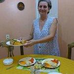Omaida serving dinner