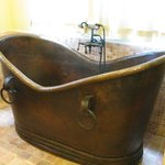 The villa is filled with high quality furnishings, such as this copper bathtub.