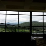 View from the main lobby over the lake & toward Sierra Blanca which is topped with clouds.