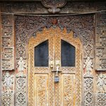 beautifully carved temple door and wall.
