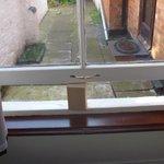 Wooden block holding a window open