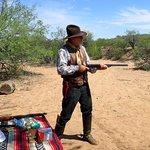 Arizona Bill demonstrates a gun on our shooting activity