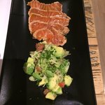 Salmon tataki with avocado.