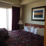 King bed in extra large suite. Balcony outside