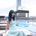 La Carmina of LaCarmina travel blog, at the rooftop pool overlooking Taipei 101