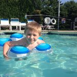 my son swimming in the pool