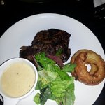 18oz aged Rump steak with pepper sauce and onion rings