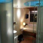 Toilet pod on left shower pod on right