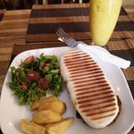 Grilled vegetables panini with chubby fries and side salad included in the meal; and passionata