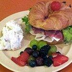 Blondie's Deli croissant sandwich with potato salad and fruit