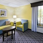 Relax in a perfectly put-together mini suite with separate sitting area