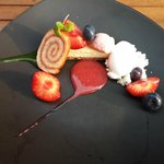 Cheesecake slice with fruit and sorbet