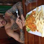My boyfriend with our classic arroz con pollo split meal :)