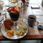 Breakfast, fresh crouisants, eggs, fruit salad, and coffee.