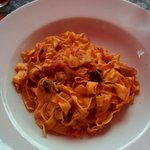 Fettuccine with tomato sauce and aubergine.