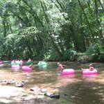 the TUBERS enjoying themselves on the river just outside our room