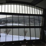 Looking out large lobby windows at snow and lake