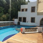 Poolside with view of 2 different room suites above pool
