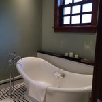 tub as well as shower in bathroom