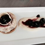 St. Andre and cherry cheesecake with white chocolate sauce