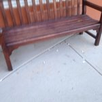 Bench at Entrance with cigarette butts