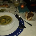 Oaxacan Broth made of tender zucchini leaves and blossoms with corn dumplings, served with a tla