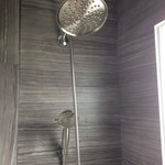 Room 14 - fully renovated bathroom with modern shower.