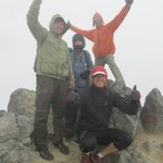 At the summit of Vulcan Imbabura with Emerson (orange jacket)