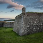 Charles Fort at sunset with Old Head off on the horizon.