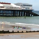 Surfing by Cromer Pier