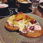 Fruit and Nut Bagel topped with Mixed Berry Mascarpone