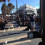 Lots of visitors enjoying the buskers and the many shops and pubs just a two minute walk from th