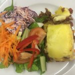Homemade lasagne and salad with a red cabbage coleslaw