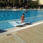 son in swimming pool