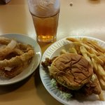 Fried pork chop sandwich special with onion rings and sweet tea.