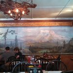 Inside the dining room...there's a great mural and neat antler lighting!
