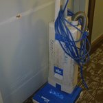 Vacuum cleaner in the corridor