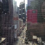 View during the day straight down Broadway to Times Square