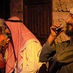 Statues of Emiratis enjoying Shisha smoking