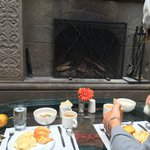 Comp. Breakfast by the fire (it's a cold building in July)