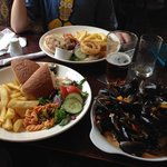 My huge plate of mussels (front) and son's burger behind