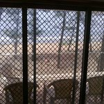 view of beach from inside the room