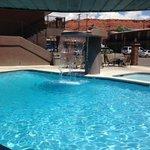 The pool has a beautiful waterfall