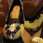 A pair of pineapple shoes displayed in the foyer