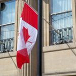 A little pice of home Canadian flag hanging off of Canada House in Trafalgar Square.