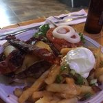 bacon cheese burger with loaded fries.  $12 @ Big Wave Daves, kapaa Hi