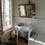 Lovely decor in the ensuite bath/shower room and in the spacious bedroom with 4-poster bed