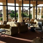 lobby + bar looking out on terraces (pools and garden are one level down)
